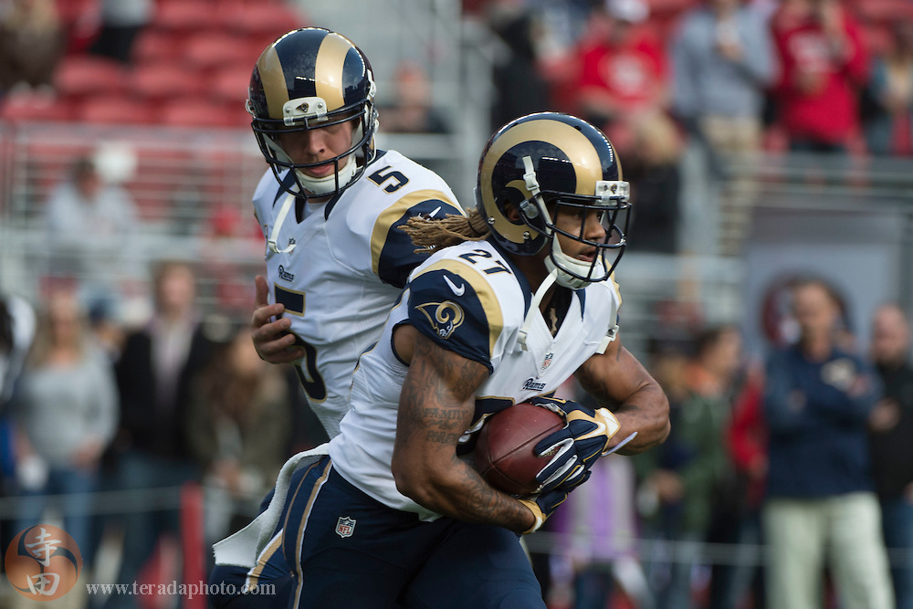 January 3, 2016; Santa Clara, CA, USA; St. Louis Rams quarterback Nick Foles (5) hands off to running back Tre Mason (27) against the San Francisco 49ers before the game at Levi's Stadium.