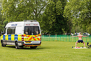 The police, in a van, still patrol but do not generally interfere - Clapham Common on the day of the Governments 'big' announcement on the possible easing of restrictions - Lambeth Council have already changed notices so that people can sit on benches for a short rest. The 'lockdown' continues for the Coronavirus (Covid 19) outbreak in London.