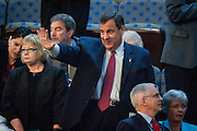 New Jersey Governor Chris Christie waves to someone in the House chamber as he waits for Pope Francis to speak to a joint meeting of Congress at the U.S. Capitol in Washington, District of Columbia, U.S., on Thursday, Sept. 24, 2015. The Pope is calling for Americans to do more to fight poverty, curb climate change and help immigrants. His visit runs through Sept. 27, and features stops in Washington, New York and Philadelphia. Photographer: Pete Marovich/Bloomberg