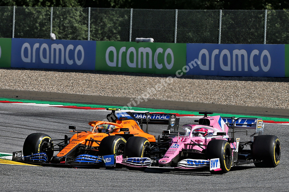 Lando Norris (McLaren-Renault) and Sergio Perez (Racing Point-Mercedes) in a close fight during the 2020 Austrian Grand Prix at the Red Bull Ring in Spielberg. Photo: XPB/Grand Prix Photo