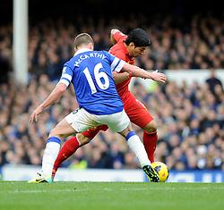 Liverpool's Luis Suarez passes Everton's James McCarthy - Photo mandatory by-line: Dougie Allward/JMP - Tel: Mobile: 07966 386802 23/11/2013 - SPORT - Football - Liverpool - Merseyside derby - Goodison Park - Everton v Liverpool - Barclays Premier League