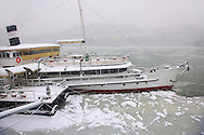 Kossuth boat in the ice on the Danube in the snow. Budapest stock photos .<br /> <br /> Visit our HUNGARY HISTORIC PLACES PHOTO COLLECTIONS for more photos to download or buy as wall art prints https://funkystock.photoshelter.com/gallery-collection/Pictures-Images-of-Hungary-Photos-of-Hungarian-Historic-Landmark-Sites/C0000Te8AnPgxjRg