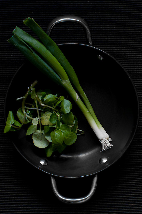 Spring greens in a pan.