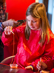City Arts Centre, Edinburgh, Scotland, United Kingdom, 9 April 2019. Edinburgh Science Festival:  India, age 8 years, has fun learning about blood at the Blood Bar drop in event at the Science Festival. <br /> <br /> Sally Anderson | EdinburghElitemedia.co.uk