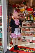 Girl in pink uniform selling candy, Takeshita Street, Harajuku, Tokyo, Japan