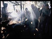 Afghan laborers eat breakfast early in the morning at the Kot-e-Sangi square in Kabul, Afghanistan, Sunday, Nov. 5, 2006.