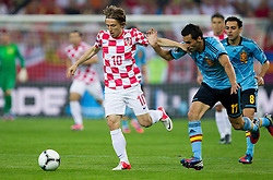 Luka Modric of Croatia vs Álvaro Arbeloa of Spain during the UEFA EURO 2012 group C match between  Croatia and Spain at PGE Arena Gdansk on June 18, 2012 in Gdansk / Danzig, Poland. (Photo by Vid Ponikvar / Sportida.com)