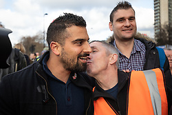 © Licensed to London News Pictures. 09/12/2018. London, UK. Far-right activist Avi Yemini (left) joins demonstrators taking part in a 'Brexit Betrayal' march in central London, campaigning against Theresa May's Brexit deal. The demonstration is backed and attended by political activist Stephen Yaxley-Lennon, also known as Tommy Robinson. A counter demonstration organised by Unite Against Fascism and Racism is also taking place on a different route. Photo credit : Tom Nicholson/LNP