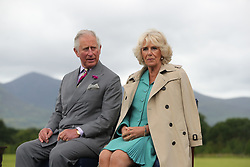 The Prince of Wales and the Duchess of Cornwall listen to speeches during a Garden Party at Killarney House as part of their tour of the Republic of Ireland.