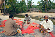 Men with their fishing net an early morning, Varkala, Kerala, India