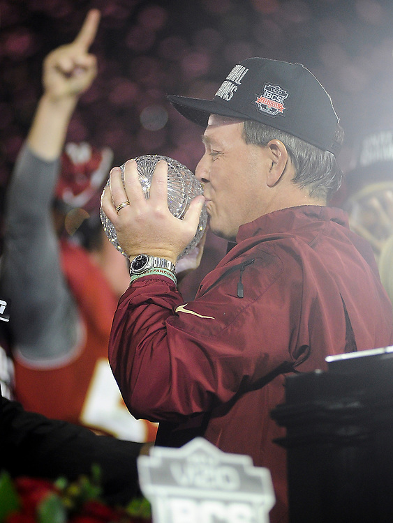 Florida State Head Coach Jimbo Fisher kisses the Coaches Trophy after the Seminoles came back to beat the Auburn Tigers. <br /> No. 1 Florida State Seminoles vs. No. 2 Auburn Tigers in the 2014 BCS National Championship Game at Rose Bowl Stadium in Pasadena, Calif., on Monday, Jan. 6, 2014. <br /> Zach Bland Photo