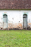 A detail of two doors at the The Roca Patricia a partly restored plantation, Principe, Sao Tome and Principe<br /> Sao Tome and Principe, are two islands of volcanic origin lying off the coast of Africa. Settled by Portuguese convicts in the late 1400s and a centre for slaving, their independence movement culminated in a peaceful transition to self government from Portugal in 1975.