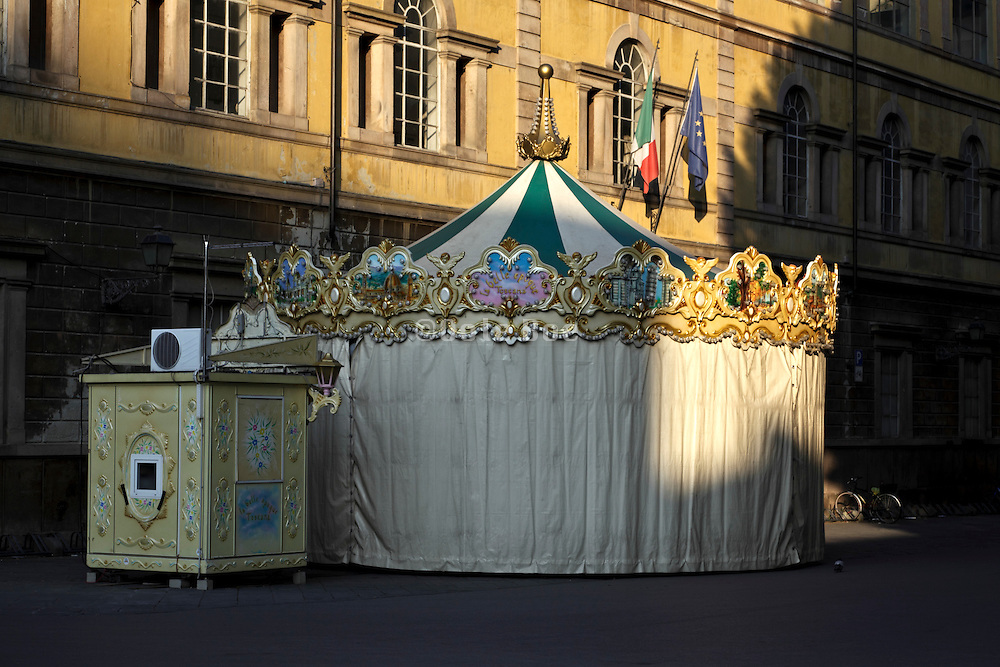 a closed up carrousel in the early morning hours Lucca Italy