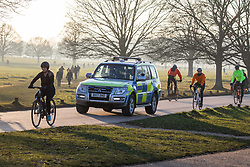 © Licensed to London News Pictures. 09/01/2021. London, UK. Police patrol a busy Richmond Park in South West London as health experts call for the lockdown to be made tougher as Covid-19 cases continue to rise after Mayor of London, Sadiq Khan declared a 'Major Incident' in London hospitals. This week, Prime Minister Boris Johnson plunged England into a 3rd lockdown as he ordered schools to close and workers to work from home as the government brings in the army to ramp up vaccinations across the country. Photo credit: Alex Lentati/LNP