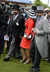 Sheikh Mohammed bin Rashid al Maktoum and his wife Princess Haya of Jordan and his son Sheikh Hamdan Bin Mohammed Bin Rashid Al Maktoum at the Investec Derby 2013 held at Epsom Racecourse, Epsom, Surrey on 1st June 2013.