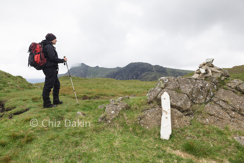 A white-painted vertical rock is a useful marker indicating the rough place to head left down to Stickle Tarn