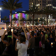 People are seen as they hold up candles during a vigil at the Dr. Phillips Center for the Performing Arts for the victims of a mass shooting at the Pulse nightclub Monday, June 13, 2016, in Orlando, Florida.  A gunman killed dozens of people in a massacre at the crowded gay nightclub in Orlando on Sunday, making it the deadliest mass shooting in modern U.S. history. (Alex Menendez via AP)