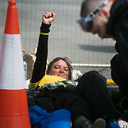13 local activists locked themselves in specially made arm tubes to block the entrance to Quadrilla's drill site in New Preston Road, July 03 2017, Lancashire, United Kingdom. A defiant councillor Mirand Cox.The 13 activists included 3 councillors; Julie Brickles, Miranda Cox and Gina Dowding and Nick Danby, Martin Porter, Jeanette Porter,  Michelle Martin, Louise Robinson,<br /> Alana McCullough, Nick Sheldrick, Cath Robinson, Barbara Cookson, Dan Huxley-Blyth. The blockade is a repsonse to the emmidiate drilling for shale gas, fracking, by the fracking company Quadrilla. Lancashire voted against permitting fracking but was over ruled by the conservative central Government. All the activists have been active in the struggle against fracking for years but this is their first direct action of peacefull protesting. Fracking is a highly contested way of extracting gas, it is risky to extract and damaging to the environment and is banned in parts of Europe . Lancashire has in the past experienced earth quakes blamed on fracking.