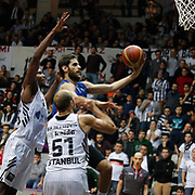Anadolu Efes's Stratos Perperoglou (2ndL) during their Turkish basketball league match Besiktas integral Forex between Anadolu Efes at BJK Akatlar Arena in Istanbul, Turkey, Monday, January 05, 2015. Photo by TURKPIX
