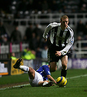 Photo: Andrew Unwin.<br />Newcastle United v Everton. The Barclays Premiership. 25/02/2006.<br />Newcastle's Peter Ramage (R) leaves Everton's Leon Osman (L) on the floor as he drives forward.
