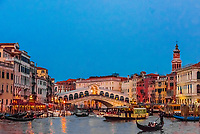 Gondolas on the Grand Canal with Rialto Bridge in background, Venice, Italy.