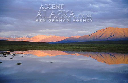 Alaska. Brooks Range reflection over a lake,