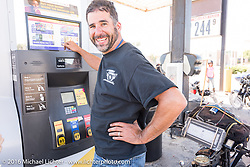 Anthony Rutledge of Connecticut stops to fuel his 1915 Harley-Davidson class-3 motorcycle at a stop on the eastern plains of Colorado during the Motorcycle Cannonball Race of the Century. Stage-9 Dodge City, KS to Pueblo, CO. USA. Monday September 19, 2016. Photography ©2016 Michael Lichter