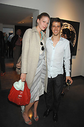 ANTONIA SPIEGEL and GUILLAUME GIRAUD at a private view of Guido Mocafico's work entitled Movement held at the Hamilton Gallery, Carlos Place, London on 1st May 2007.<br />