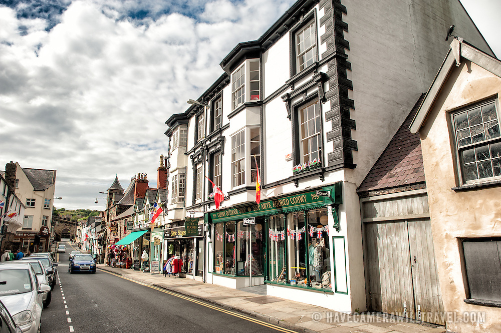 Shops on Castle Street, one of the main streets of Conwy that runs parallel to the waterfront. Conwy is an historic walled town most famous for Conwy Castle, which stands at the southern end of Castle Street.