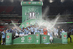 BRITAIN-LONDON-FOOTBALL-CARABAO CUP FINAL-CHELSEA VS MAN London.(190224) -- LONDON, Feb. 24, 2019  Manchester City's players celebrate with the trophy after the Carabao Cup Final match between Chelsea and Manchester City at Wembley Stadium in London, Britain on Feb. 24, 2019. Manchester City won 4-3 on penalties after a 0-0 draw.  FOR EDITORIAL USE ONLY. NOT FOR SALE FOR MARKETING OR ADVERTISING CAMPAIGNS. NO USE WITH UNAUTHORIZED AUDIO, VIDEO, DATA, FIXTURE LISTS, CLUB/LEAGUE LOGOS OR ''LIVE'' SERVICES. ONLINE IN-MATCH USE LIMITED TO 45 IMAGES, NO VIDEO EMULATION. NO USE IN BETTING, GAMES OR SINGLE CLUB/LEAGUE/PLAYER PUBLICATIONS. (Credit Image: © Matthew Impey/Xinhua via ZUMA Wire)
