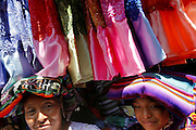 Scenes from the Sunday market in Zacualpa, Guatemala.  A whirlwind of color and smells brings people from all of the neighboring vilages to the city square to sell their goods and buy them too.