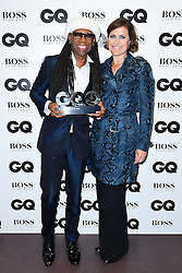 EMBARGOED UNTIL 11.30PM TUESDAY 6TH SEPTEMBER Alison Moyet (right) presents Nile Rodgers with the award for Icon in the press room at the GQ Men of the Year Awards 2016 in Association with Hugo Boss held at The Tate Modern in London. PRESS ASSOCIATION Photo. Picture date: Tuesday September 6, 2016. See PA story SHOWBIZ GQ. Photo credit should read: Ian West/PA Wire