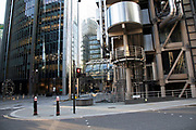 Rush hour beside the Lloyds Building in the City of London financial district is virtually deserted due to the Coronavirus outbreak on 23rd March 2020 in London, England, United Kingdom. Following government advice city workers are staying at home to work leaving the streets quiet, empty and eerie. Coronavirus or Covid-19 is a new respiratory illness that has not previously been seen in humans. While much or Europe has been placed into lockdown, the UK government has announced more stringent rules as part of their long term strategy, and in particular social distancing.