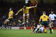 Australian players are flying as Matt Giteau (l), Michael Hooper © and no 8 David Pocock stop a Fiji attack from Leone Nakarawa of Fiji. Rugby World Cup 2015 pool A match, Australia v Fiji at the Millennium Stadium in Cardiff, South Wales  on Wednesday 23rd September 2015.<br /> pic by  Andrew Orchard, Andrew Orchard sports photography.