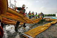 HOPEDALE, LOUISIANA.  Workers unload Oil boom to be laid by local fishermen in Hopedale, Louisiana.  Many local shrimpers have been shut down but have been hired by British Petroleum to lay boom in sensitive areas.  after a massive oil spill in the Gulf of Mexico.