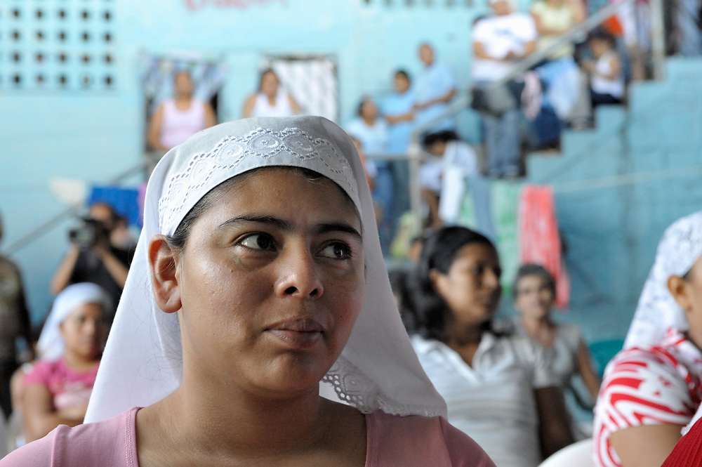 Participants in an evangelical worship service in the women's section of a prison in Sensuntepeque, El Salvador.