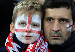 A young England fan shows his support during the 2018 FIFA World Cup Qualifying, Group F match at Wembley Stadium, London.