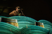 "Maryn Jacques of the Tiger Lillies plays the piano accordion behind a scrim at the Celebrate Brooklyn concert. The Tiger Lillies performed their song cycle based on Coleridge's ""Rime of the Ancient Mariner""."