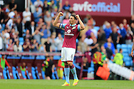 Tommy Elphick of Aston Villa , the captain, celebrates towards the fans at the end of the match.EFL Skybet championship match, Aston Villa v Rotherham Utd at Villa Park in Birmingham, The Midlands on Saturday 13th August 2016.<br /> pic by Andrew Orchard, Andrew Orchard sports photography.