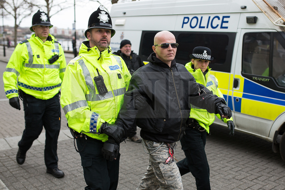 "© Licensed to London News Pictures . 21/03/2015 . Newcastle , UK . A Polish man at the demo is arrested for Incitement to Racial Hatred following the burning of an Israeli flag . Neo-Nazis and skinheads from across Europe organise a "" White Man March "" in Newcastle , under the banner of "" National Action "" . Photo credit : Joel Goodman/LNP"