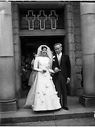30/06/1959<br /> 06/30/1959<br /> 30 June 1959<br /> Wedding of James Hendron, Derrykeerin, Portadown and Miss Eileen McCabe, 9 Maretimo Terrace, Blackrock at St. Patrick's Church, Skerries, Co. Dublin. Picture shows Bride and Groom leaving the church after the wedding.