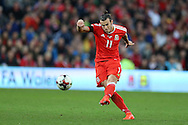 Gareth Bale of Wales takes a free-kick.  Wales v Georgia , FIFA World Cup qualifier, European group D match at the Cardiff city Stadium in Cardiff on Sunday 9th October 2016. pic by Andrew Orchard, Andrew Orchard sports photography