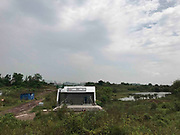 CHONGQING, CHINA - MAY 08: <br /> <br /> Metro Station Opens At Wasteland<br /> <br /> The exit one of Caojiawan Station on Chongqing Rail Transit Line 6 is seen at a wasteland on May 8, 2017 in Chongqing, China. The metro station exits hidden at a wasteland in Chongqing<br />  Caojiawan Station on Chongqing Rail Transit Line 6, opened one exit in 2015. As few passengers board from Caojiawan Station, other two exits are hardly seen in the grass, and there's no path leading to the station on the wasteland. <br /> ©Exclusivepix Media