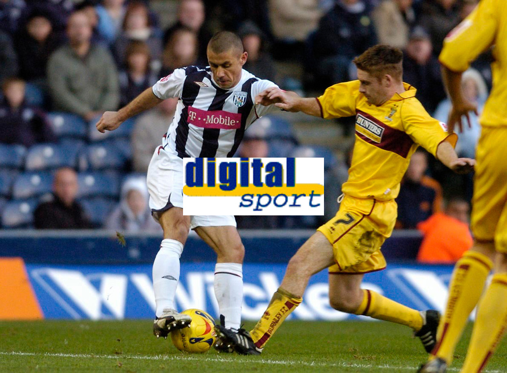 Photo: Leigh Quinnell.<br /> West Bromwich Albion v Burnley. Coca Cola Championship. 18/11/2006. West Broms Kevin Phillips attemps to pull the ball from Burnleys  James O'Connor.