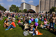 Picnicers in front of the outdoor ballroom in the Jubillee Gardens during the Thames Festival 08