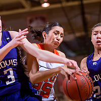 120713       Cable Hoover<br /> <br /> Gallup Bengal Rebecca Herrera (25) fights with Clovis Wildcat Danni Williams (3) for a rebound during the final of the Gallup Invitational Saturday at Gallup High School.
