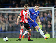 Chelsea's John Terry tussles with Southampton's Jay Rodriguez during the Premier League match at Stamford Bridge Stadium, London. Picture date: April 25th, 2017. Pic credit should read: David Klein/Sportimage