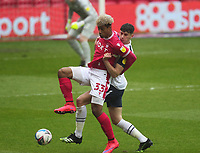 Preston North End's Jordan Storey in action with  Nottingham Forest's Lyle Taylor<br /> <br /> Photographer Mick Walker/CameraSport<br /> <br /> The EFL Sky Bet Championship - Nottingham Forest v Preston North End - Saturday 8th May 2021 - The City Ground - Nottingham<br /> <br /> World Copyright © 2020 CameraSport. All rights reserved. 43 Linden Ave. Countesthorpe. Leicester. England. LE8 5PG - Tel: +44 (0) 116 277 4147 - admin@camerasport.com - www.camerasport.com