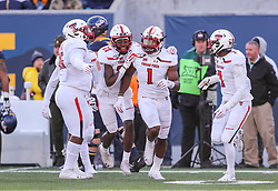 Nov 9, 2019; Morgantown, WV, USA; Texas Tech Red Raiders linebacker Jordyn Brooks (1) recovers a fumble and celebrates with Texas Tech Red Raiders linebacker Xavier Benson (37) and Texas Tech Red Raiders defensive back Adrian Frye (7) during the third quarter against the West Virginia Mountaineers at Mountaineer Field at Milan Puskar Stadium. Mandatory Credit: Ben Queen-USA TODAY Sports