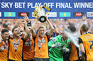 Michael Dawson  of Hull City lifts the Sky Bet Championship Playoff Trophy with his teammates .Skybet football league Championship play off final match, Hull city v Sheffield Wednesday at Wembley Stadium in London on Saturday 28th May 2016.<br /> pic by John Patrick Fletcher, Andrew Orchard sports photography.